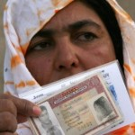 Fatma Buaha shows the Spanish identity card of her brother at the port of Gran Tarajal